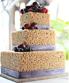Some may say this is the tackiest cake for a wedding but I say it is shear genius.  I wouldn't pass up a slice of this wedding cake.  YUM!  Love me some rice krispy treats!