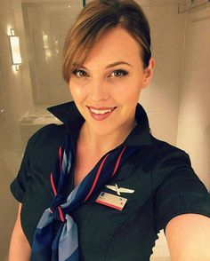 Happy to give up and do whatever this beautiful American Airlines stewardess tells me to do.