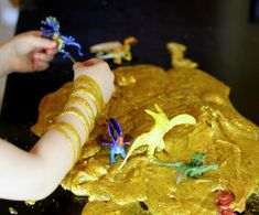 Golden Glitter Slime from Fun at Home with Kids - glue and liquid starch make the slime, then add paint or glitter (or both) as you like.