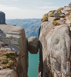 Kjeragbolten, a boulder in the Kjerag mountain located in Norway, is wide enough for you to stand on. The rock measures five cubic meters, and the drop to the bottom is 3,228 feet.