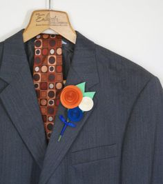 pumpkin orange royal blue ivory traditional boutonniere style