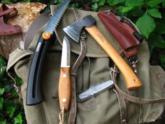 Folding saw, knives, Bruks hatchet, norwegian canvas rucksack