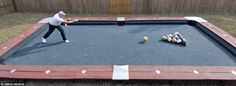 This bowling version of pool is an interesting DIY. Naturally it would have to be built in a transportable way and it can't be too big. Perhaps build it so that a ball can go in one of the holes, but it sits there and then you take it out, (this saves from creating a complicated transport system). -SvH