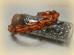 orange braided metal bracelet, waxed cotton braided
