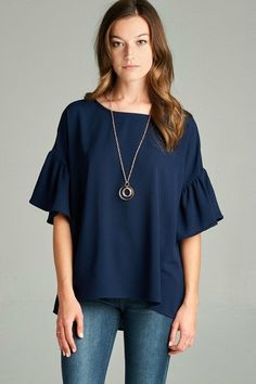 Classic and versatile blouse in Navy featuring bell sleeves with a round neckline and slight high-low fit. Great to dress up or down! If in-between sizes we recommend ordering the smaller of the two. Bell Sleeve Blouse, Bell Sleeves, Bell Sleeve Top, Dress Up, Tunic Tops, Navy, My Style, How To Wear, Shirts