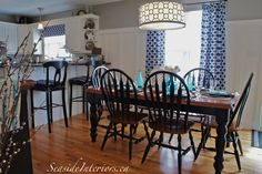 A combination of navy, white and turquoise brings an easy breezy summer feel to a kitchen! www.seasideinteriors.ca