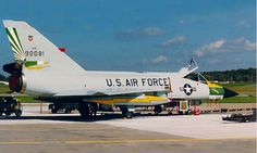 A Convair F-106A Delta Dart from the 49th FIS sits on the ramp at its base.
