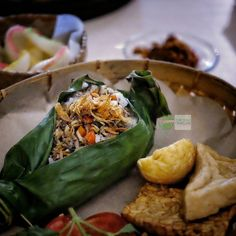 #Discover #IndonesianFood  Nasi Bakar refer to steamed rice seasoned with spices and ingredients and wrapped in banana leaf secured with lidi semat and later grilled upon charcoal fire. The burned banana leaf produced a unique aroma upon the rice.  Where is the best Nasi Bakar you can find in Bali? #LetsShare