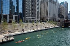 designed by ross barney architects, the completed chicago riverwalk development - a 1.5 mile promenade along the city's river - has opened to the public.