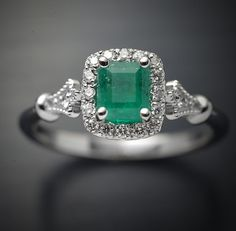 Engagement Ring with Natural Colombian green Emerald not treated  halo in Micro pave sett in 18kt white gold