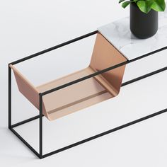 Perforé Side Table consists of a marble top, perforated copper magazine rack and powder-cotaed metal base.