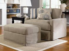 Nice Oversized Chair With Ottoman In Light Grey Color And Stripped Also Flower Pattern Cushion Near Black Table