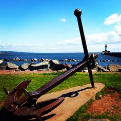 Explore Duluth Harbor on Lake Superior to see beautiful views of the Duluth North Pier Lighthouse. #lighthouse #lakesuperior #OnlyinMN