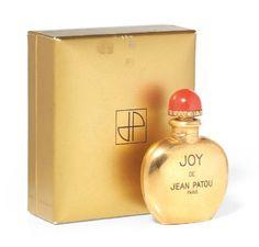 *JEAN PATOU «Joy» modèle flaconette, pour le parfum Joy, doré,