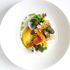 Red mullet and cockles with samphire fresh corn, broccoli with coconut and sweet potato pureé & herb oil by chef jason howard #plating #gastronomy