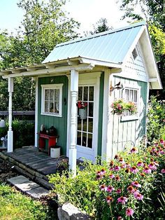 Garden shed with a tiny veranda from Garden Timing #rusticsheshed