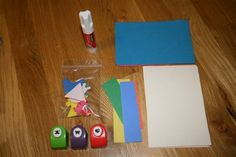 Collage bag- glue stick, foam paper, note cards, stickers, paper punches, strips of construction paper