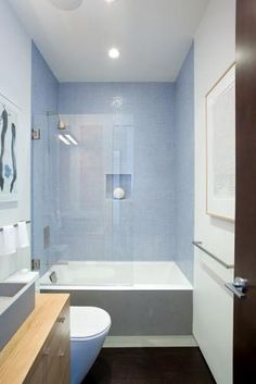Small bathroom pic 1/2 ~ clean lines, short tub, muted palette blue + gray + wood (Alta Plaza Residence, J. Weiss Design | Remodelista, Photo: Laura Plageman)