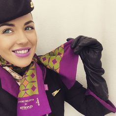 "Etihad Stewardess improvising when ordered by the captain to restrain a disruptive male passenger. ""I'm going to have to tie you up,"" she tells the now calm man, removing her uniform scarf, ""captain's orders. He doesn't want to take any chances!"""