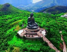 Tian Tan Buddha on Lantau Island, Hong Kong. Completed in 1993, the statue is located near the Po Lin Monastery and symbolises the harmonious relationship between man and nature. It is a major centre of Buddhism in Hong Kong, and is also a popular tourist attraction. Vistors have 240 steps to climb to reach this immense bronze statue. At 112 ft tall and weighing in at 275 tons, it is one of the world's largest Buddhas.
