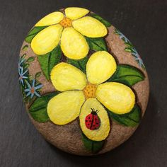 "5 Likes, 1 Comments - Sandra Harris (@rockinart58) on Instagram: ""#flowers #ladybug #paintedrocks"""