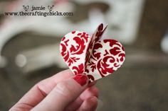 sm heart ornament.  double sided paper - slit one top and one bottom and slide together.  Punch hole and tie a ribbon on