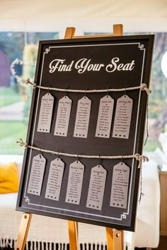 Blackboard table plan with luggage tag tables tied to rope - Image by Cassandra Lane Photography - Raimon Bundo wedding dress for a classic wedding in Iscoyd Park with grey bridesmaid dresses, morning suits and bright florals. New Wedding Games, Wedding Reception Signs, Wedding Planning, Wedding Sitting Plan, Seating Plan Wedding, Seating Plans, Blackboard Wedding, Pink Wedding Invitations, Wedding Favors