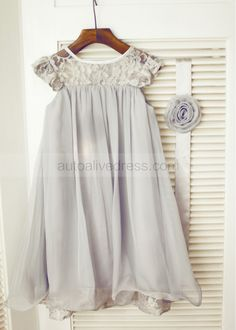 The dress is made of high quality lace and chiffon fabric.This style is beautifully designed with sheer lace neckline, cap sleeves, lace trim/curly chiffon hem and detachable flower sash.It is really perfect for wedding,party,birthday or baptism christening.If you use for baptism,we can make in ivor