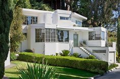 The exterior of the 1937 house, designed by architect William Kesling in the Streamline Moderne style, included porthole windows, second-floor observation deck and gangplank front steps.