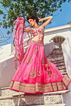 Love this shocking pink lengha for a mendhi!