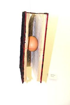 Life - Mixed Media Installation Book, egg, earth, thread and found metal fixing
