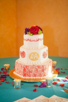 bright wedding cake with orange design for Indian-American wedding