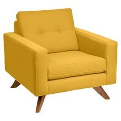 "Linen-upholstered mustard arm chair with button tufting and a midcentury-inspired design.   Product: ChairConstruction Material: Wood and linenColor: MustardFeatures: Made in the USADimensions: 34"" H x 38"" W x 38"" D"