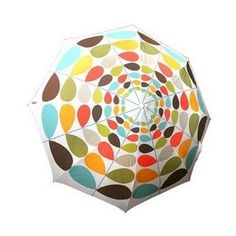 "Cheer up a rainy day with this colorful and fun Orla Kiely Umbrella. Orla's signature multi-stem print adorns the outside of this collapsible umbrella. It folds down to 10"" and is perfectly sized to fit in your bag for that chance of rain."