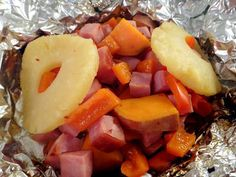"Pineapple, Ham & Sweet Potato Foil Packet 4 oz. Ham, cut in 1"" cubes 2 Slices of Pineapple, save juice 1/2 Lrg sweet potato, diced 1"" cubes 1/2 Red Bell Pepper 1 Tbs Brown Sugar 2 Tbs Pineapple Juice 1 Tbs Butter Red Pepper Flakes, to taste Make a large double-layer of foil, spray with Pam. Place everything in, place butter on top, sprinkle brown sugar, top with pineapple juice, seal the foil. Leave room in packet to allow air to flow thru. Cook on BBQ for 20 min, flip 1/2 way thru"
