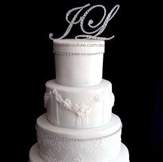 Monogram #wedding #cake toppers embellished with #Swarovski Crystal.  Cake design by Deliciously Decadent.