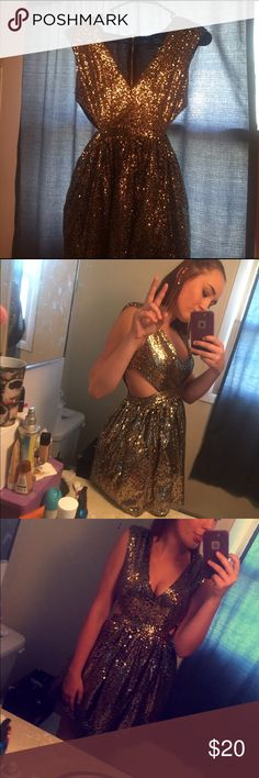 Gold sequined medium length dress Used once for homecoming this year! A few inches above the knee with slide slits in the side! Coming from a smoke-free home. No rips or tears. Black material covered in gold sequence and bough from forever 21. Size medium. Forever 21 Dresses Midi