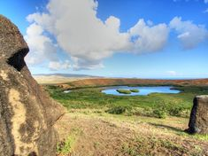Photo by @andywcoleman // After exploring the slopes of Rano Raraku otherwise known as the quarry where hundreds of the giant stone moai of Easter Island remain in various stages of completion we hiked to the top of this ancient volcano to see the beautiful lake within.  This area also has a few moai who will guard it throughout eternity.  #easterisland by natgeotravel