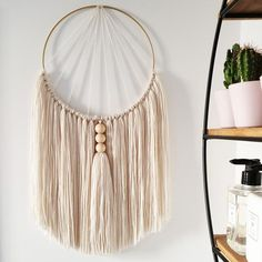 Cream macrame wall hanging – Home accessory with natural wooden beads and handmade tassel. Featured in Style at Home magazine. Yarn Wall Art, Yarn Wall Hanging, Wall Hangings, Handmade Wall Hanging, Macrame Design, Macrame Art, Macrame Knots, Macrame Mirror, Macrame Curtain