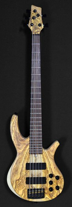 Description: Overwater Progress Series IV Standard Bolt-on 5 (Ser. No 17-3983) Condition: New - mint Specifications: Neck: I piece Maple with scarfed headstock