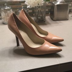 Beige stilettos by Guess Perfect pair of guess nude stilettos. Only a 2 1/2 - 3 inch heel. Super comfortable and classic. Worn a few times, only wear is on bottom as shown in photo. Wooden heel makes it easy to dress down. Guess Shoes Heels