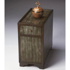 Chairside Chest - Butler Loft - 2181140. Chairside Chest - Butler Loft - 2181140 This attractive two-tone chairside chest is abundantly practical with convenient storage. An ebony finish along the edges outlines the clean lines of the design, and frames the distinct.. . See More Chests at http://www.ourgreatshop.com/Chests-C698.aspx