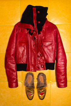 """Inside Kirna Zabête's CEO Beth Buccini Closet: """"This is Balenciaga from one of Nicolas [Ghesquière]'s first collections."""" --- Balenciaga red bomber jacket and gold Gucci fur slippers.    Coveteur,com"""