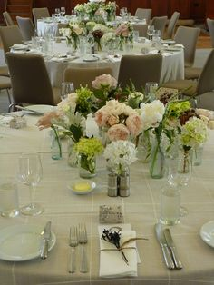 Table linen from Table Art. Hen Patchwork overlay, latte underlay, white linen spoke napkins. Floral by Flower Jar.  www.tableart.com.au