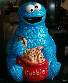 """Cookie Monster cookie jar - """"The great man is he who does not lose his child's heart."""" - I've seen that quotation attributed to Confucius, I think. Teapot Cookies, Biscuit Cookies, Kinds Of Cookies, Cute Cookies, Sweet Cookies, Antique Cookie Jars, Sesame Street Cookies, Disney Cookies, Biscuits"""