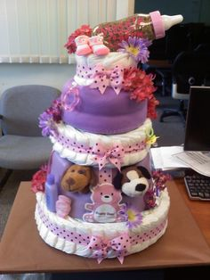 So much fun to make!! Diaper Cake: First tier - diapers, Second tier - Bumbo, Third tier - diapers covered in receiving blanket, Fourth tier - diapers.