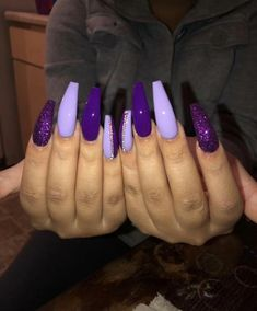 There are three kinds of fake nails which all come from the family of plastics. Acrylic nails are a liquid and powder mix. They are mixed in front of you and then they are brushed onto your nails and shaped. These nails are air dried. Purple Acrylic Nails, Best Acrylic Nails, Purple Glitter Nails, Purple Stiletto Nails, Dark Purple Nails, Violet Nails, Purple Nail Designs, Acrylic Nail Designs, Acrylic Art