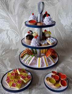 tea stand with cakes and sandwiches