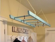 Painted wooden ladder as a hanging drying rack.