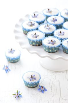 Light, airy almond fairy cakes topped with poured fondant icing and an edible candied borage flower. Tea Cakes, Mini Cakes, Cupcake Cakes, Beignets, Poured Fondant, Fondant Icing, Cotton Candy Frappuccino, Cupcake Recipes, Dessert Recipes